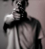 Man shooting gun photo
